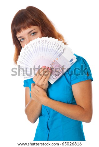 a beautiful girl is holding money in her hands. isolated on white background