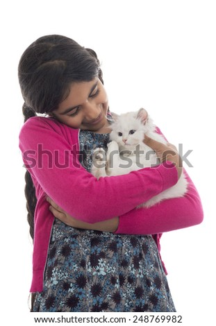 A Beautiful Girl Playing with Her Cat Isolated on White Background - stock photo