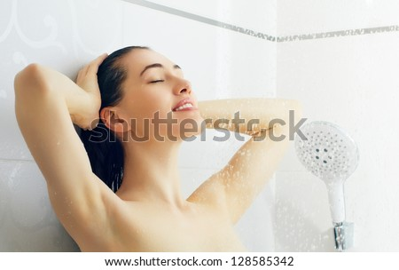 a beautiful girl standing at the shower - stock photo