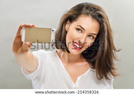 a beautiful girl taking selfie - stock photo