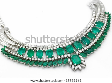 A beautiful green emerald necklace with diamonds - stock photo