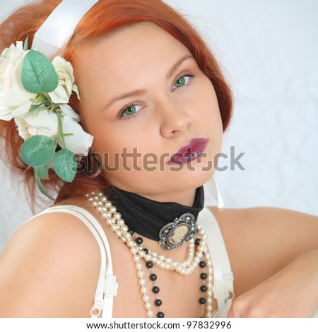 a beautiful green-eyed girl in lingerie - stock photo