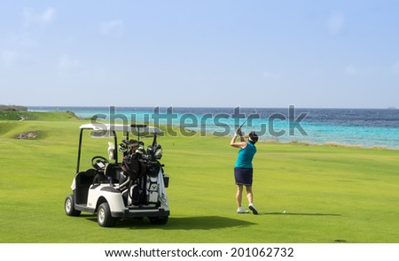 A beautiful green grass golf course on the Island of Curacao Caribbean  - stock photo