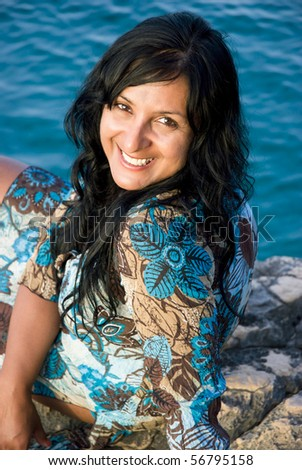 A beautiful happy smiling indian woman - stock photo