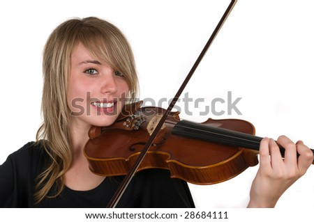 A beautiful happy teenager playing her violin - stock photo