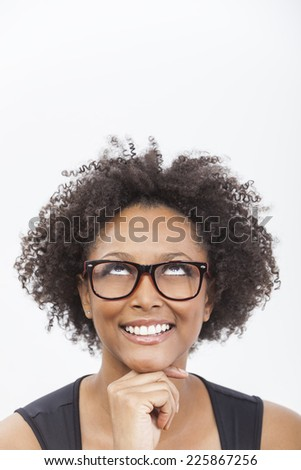 A beautiful intelligent mixed race African American girl or young woman looking up happy  smiling and wearing geek glasses - stock photo