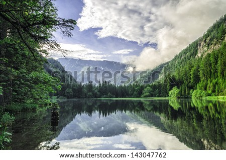 A beautiful lake (Durr Lake, Austria) surrounded by mountains. - stock photo