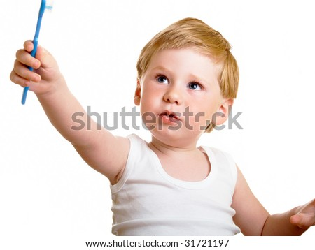 a beautiful little boy cleans your teeth on a white background - stock photo