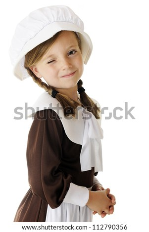 """A beautiful little """"pilgrim"""" winking at the viewer.  On a white background. - stock photo"""