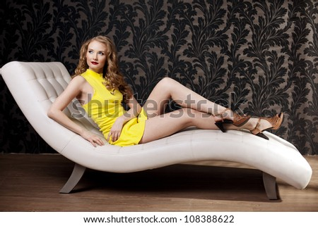 A beautiful, luxury woman in a short yellow dress - stock photo