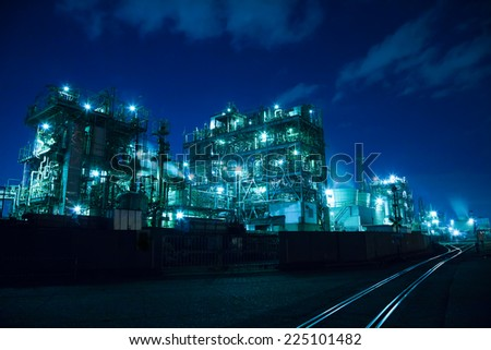 A beautiful manufacturing plant in night - stock photo