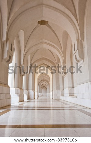 A beautiful marble corridor leading to the palace of the Sultan of Oman. - stock photo