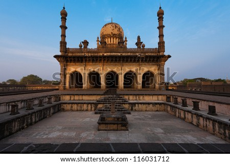 A beautiful morning light is cast on the ancient Ibrahim Roza mausoleum and center fountain in Bijapur, India, the purported inspiration for the Taj Mahal of Agra