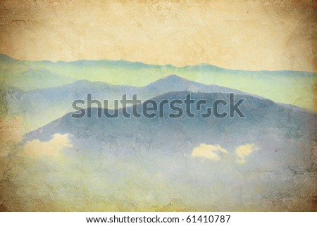 a beautiful mountain landscape on the grunge background