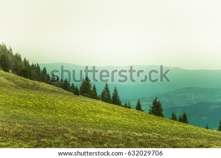 A beautiful mountain pass landscape of Tatra mountains in Slovakia. Colorful warm spring haze look.