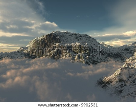 A beautiful mountain top poking out of the clouds - stock photo