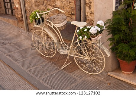 A beautiful old white bicycle on the street in Italy