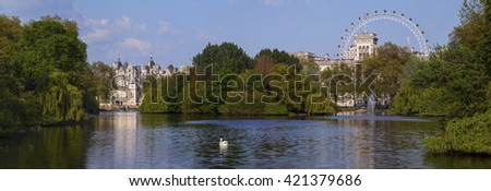 A beautiful panoramic view of St. James's Park in London with the Horse Guards building and London Eye in the background. - stock photo
