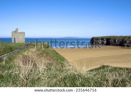 a beautiful path with benches with views of Ballybunion beach and castle - stock photo