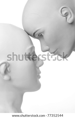 a beautiful portrait of two mannequins conceptualizing a lesbian couple in love - stock photo