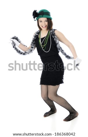 "A beautiful Roaring 20s teen ""flapper""  happily kicking a leg while fanning herself with another.  On a white background."