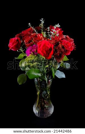 A beautiful rose bouquet in a clear glass vase. This image is suitable for postcards and gift cards.