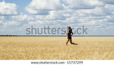 a beautiful running young woman over sky background
