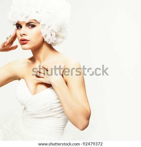 A beautiful sexual girl is in a wedding-dress, wedding decoration - stock photo