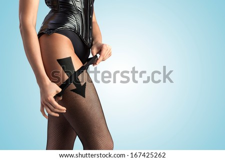 A beautiful sexy girl taking off her fishnet pantyhose according to the arrow sign. - stock photo
