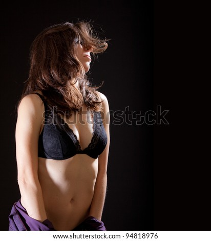 A beautiful, sexy woman stripping off her dress. - stock photo