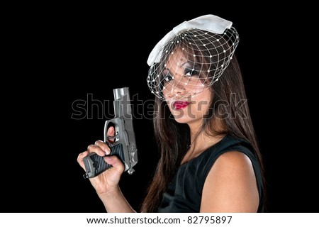 A beautiful, sinister Asian woman holding a pistol. - stock photo
