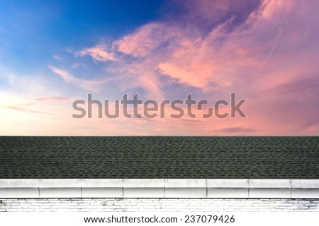 a beautiful sky at sunset with Roof - stock photo