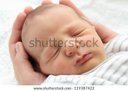 A beautiful sleeping newborn baby - close up
