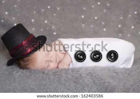 A beautiful sleeping newborn wearing a Frosty the snowman costume.