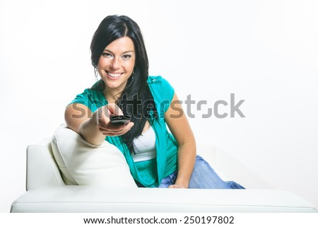 A Beautiful smiling woman relaxing in sofa - stock photo
