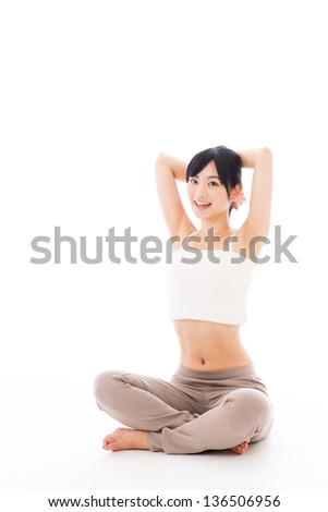 a beautiful sporty woman exercising on white background