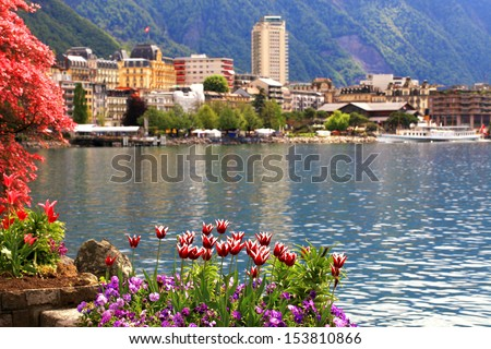 A beautiful spring landscape with flowers, Lake Geneva and view of Montreux, Switzerland. - stock photo