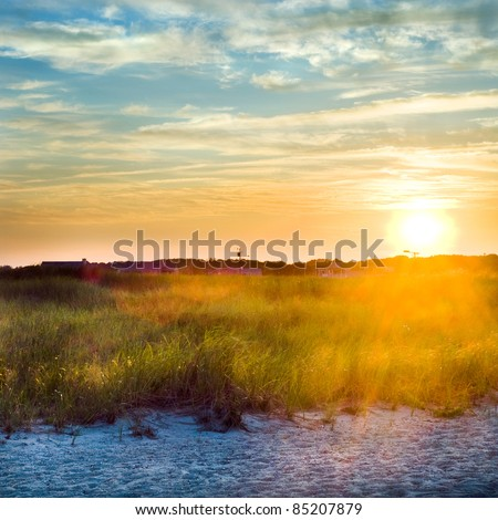 A beautiful square image of a sunset at the beach. - stock photo