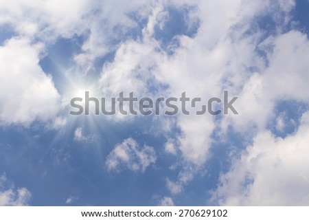 A beautiful sunny cloudy sky with sun rays - stock photo