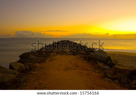A beautiful sunrise and breakwater at Noosa Beach, Sunshine Coast, Queensland, Australia - stock photo