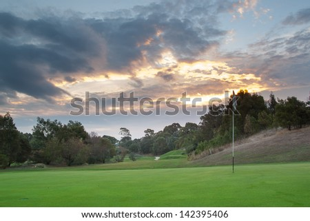 A beautiful sunset over a golf course