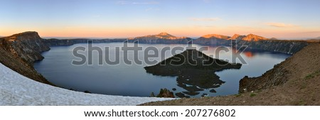 A beautiful sunset over Crater Lake caldera in Oregon, USA. - stock photo