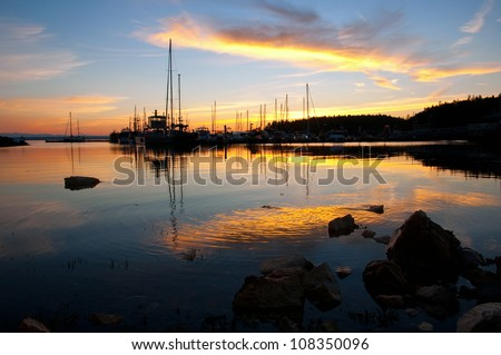 A beautiful sunset over the Lund Harbor in British Columbia, Canada. - stock photo