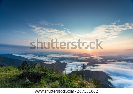 a beautiful sunset scene, mountain with sea of mist at Pha Tang, Chiangrai, Thailand - stock photo
