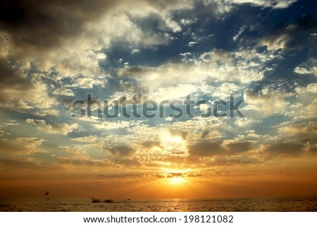A beautiful sunset sky over the sea. - stock photo