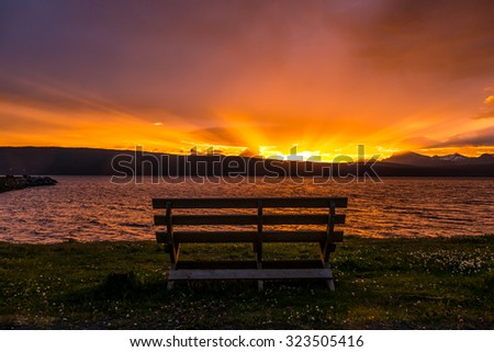 A beautiful sunset with nobody experiencing it. - stock photo