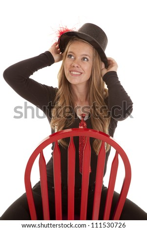 A beautiful teen girl looking up while sitting on her red chair - stock photo