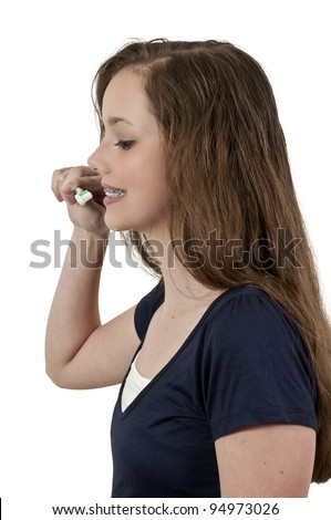 A beautiful teenage woman practicing good oral dental care by brushing her teeth