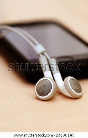 A beautiful touchscreen Mp3 player isolated on an peach back ground - stock photo