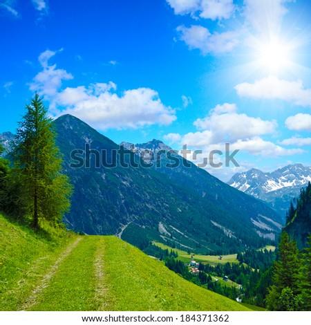 a beautiful trekking path in the austrian alps - stock photo